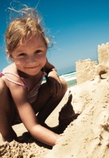 girl-beach-sandcastle