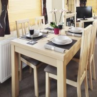 Holywell Holiday Home dining area at Monkey Tree Holiday Park