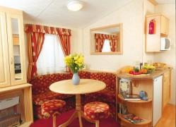 Crantock Holiday Home dining area at Monkey Tree Holiday Park near Newquay