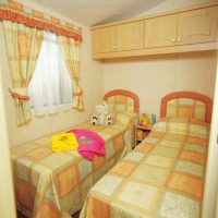 Crantock Holiday Home twin bedroom at Monkey Tree Holiday Park near Newquay