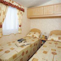 Towan Holiday Home twin bedroom at Monkey Tree Holiday Park near Newquay