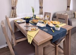 Watergate Holiday Home dining area at Monkey Tree Holiday Park