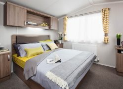 Watergate Holiday Home double bedroom at Monkey Tree Holiday Park