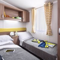 Watergate Holiday Home twin bedroom at Monkey Tree Holiday Park